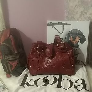 Kooba whiskey/toffee color handbag. NWOT